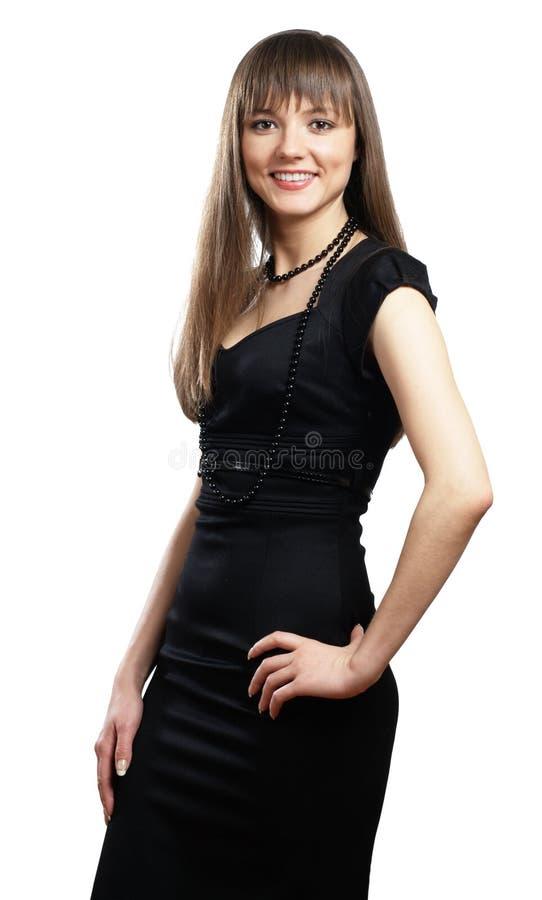Mulher nova de sorriso no vestido preto foto de stock
