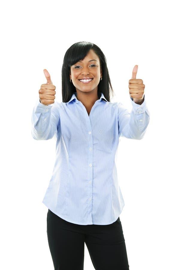 Mulher nova de sorriso que dá os polegares acima fotografia de stock royalty free