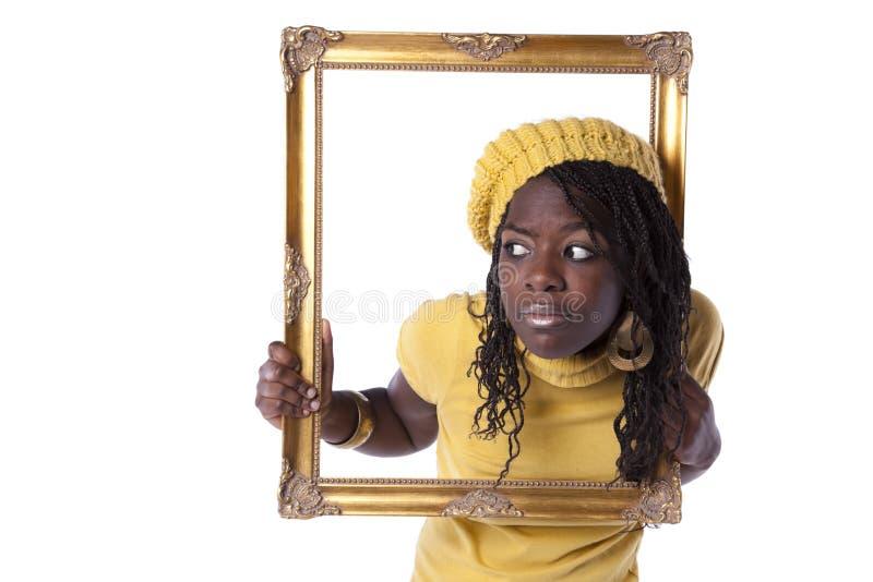 Mulher nova dentro de um frame de retrato foto de stock
