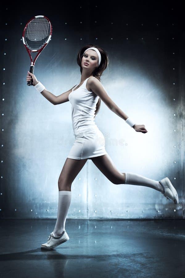 Mulher nova do jogador de ténis fotos de stock