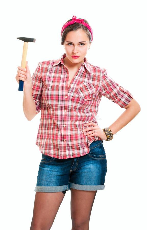 Mulher nova do trabalhador com martelo fotografia de stock royalty free