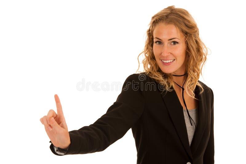 Mulher nova dos busienss que pressiona o botão virtual isolado sobre o branco fotografia de stock royalty free