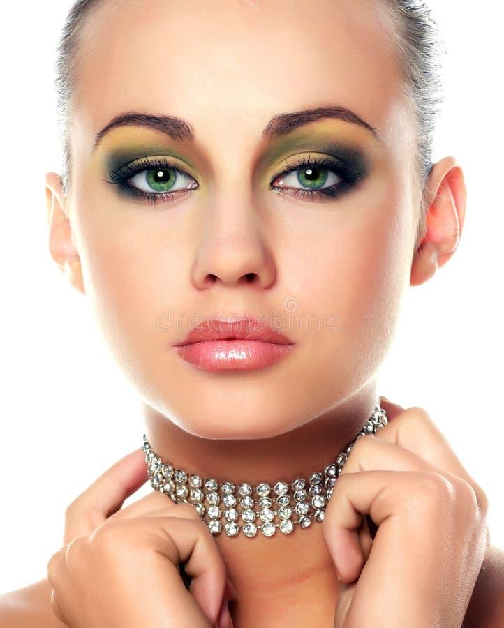 Mulher nova e diamantes imagem de stock royalty free