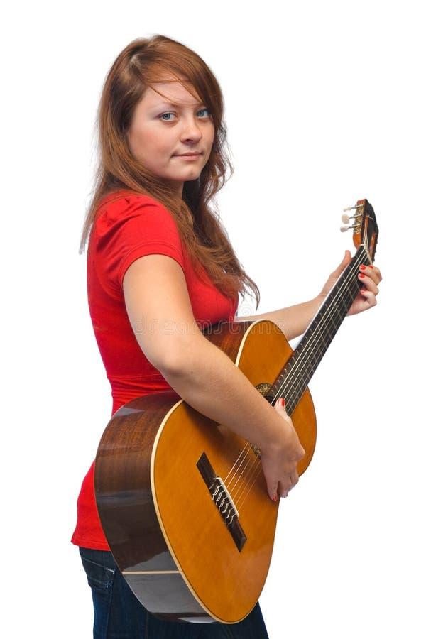 Mulher nova e guitarra imagens de stock