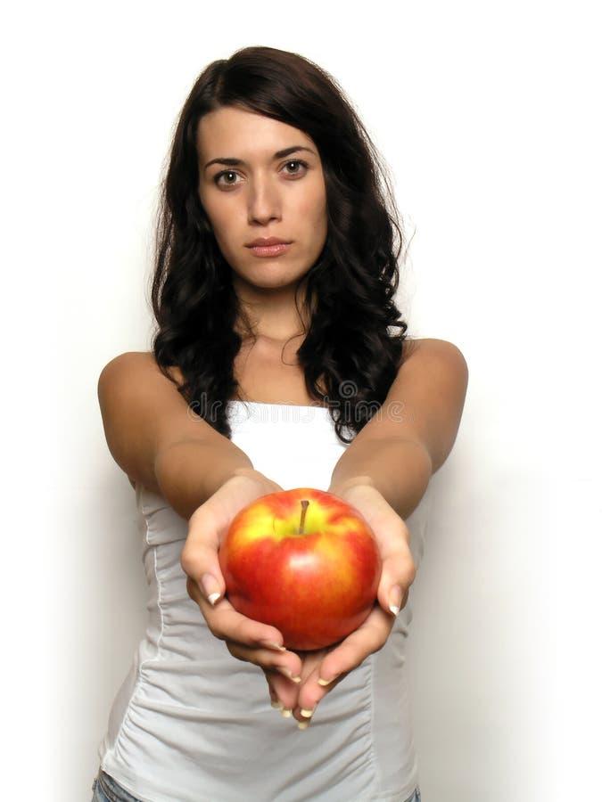 Mulher nova e maçã imagens de stock royalty free