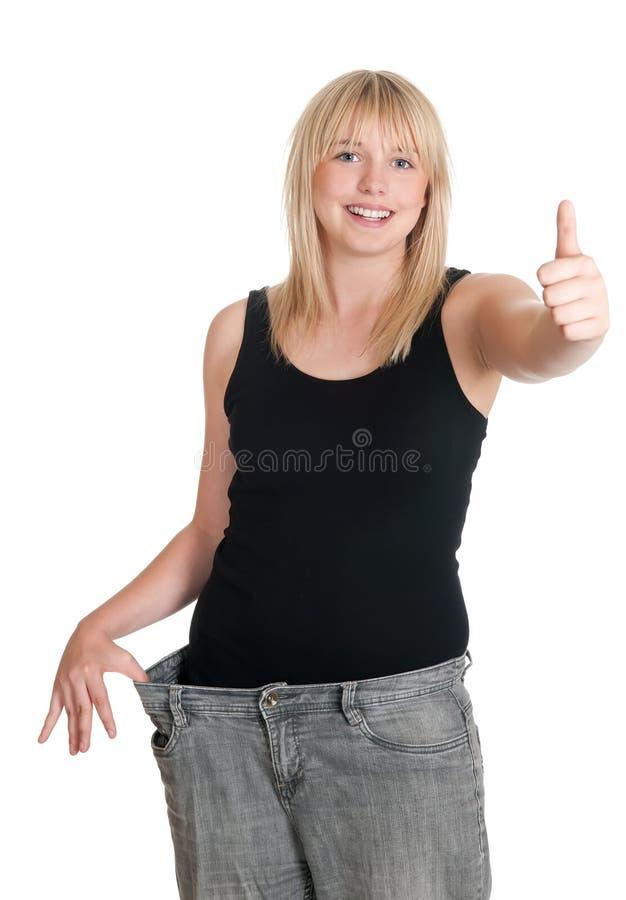 Mulher nova em peso perdido das calças desproporcionados imagens de stock royalty free