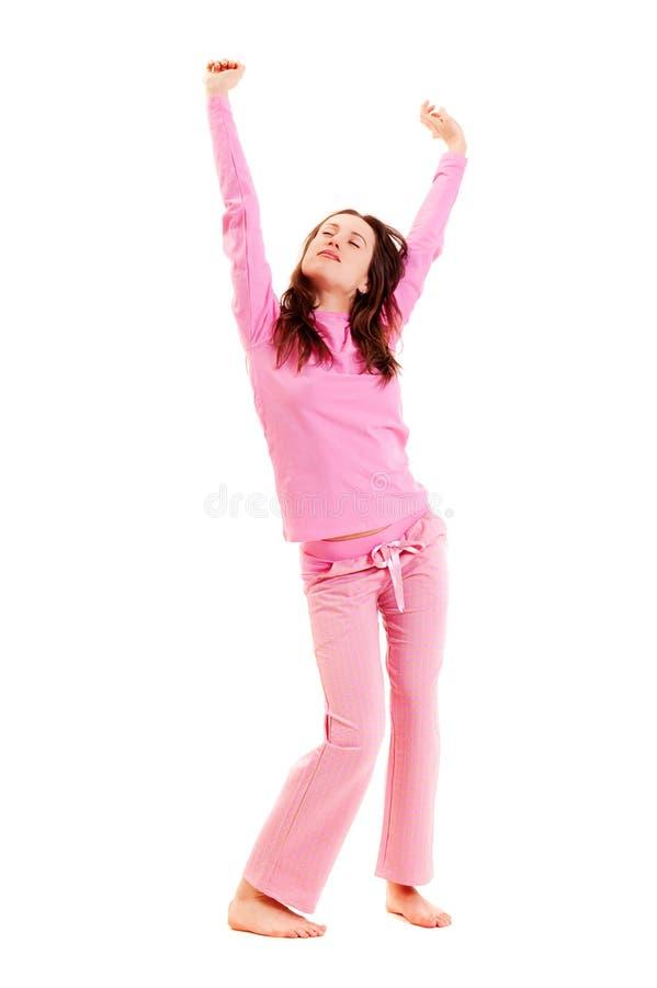 Mulher nova em pijamas cor-de-rosa foto de stock royalty free