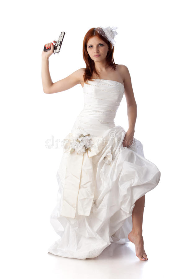 Mulher nova em um vestido de casamento com injetor. foto de stock royalty free