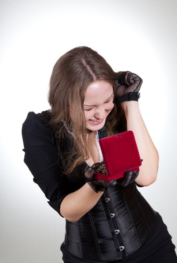Mulher nova emocional com caixa de presente fotografia de stock royalty free