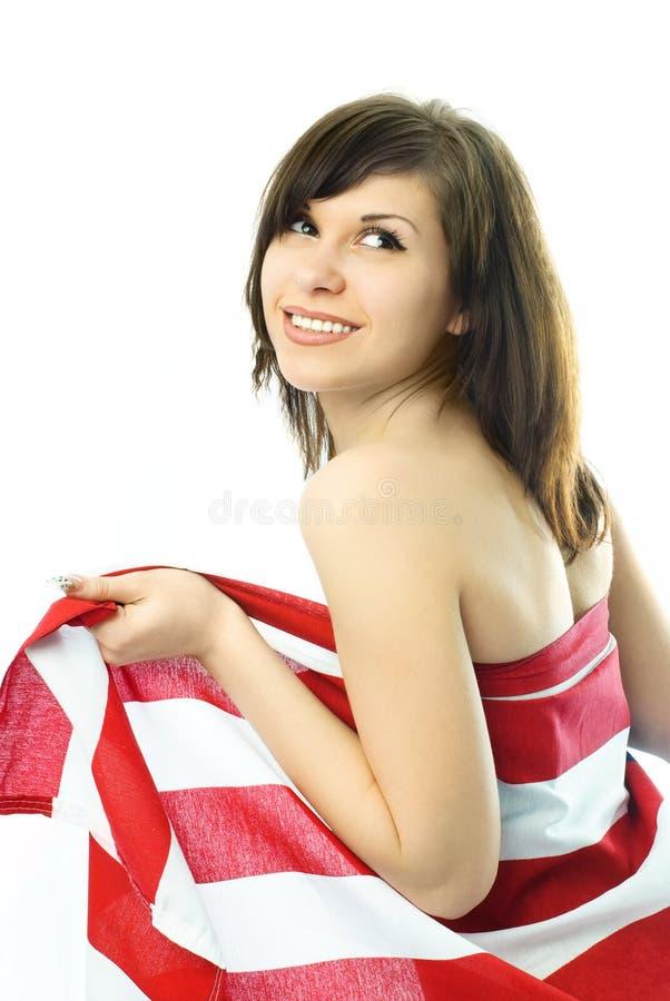 Mulher Nova Envolvida Na Bandeira Americana Foto de Stock