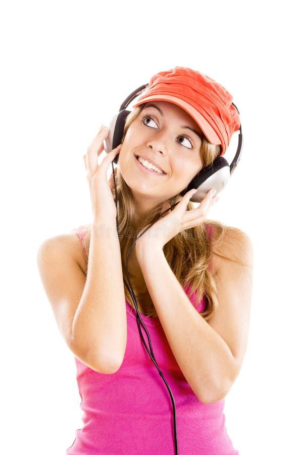A mulher nova escuta música fotos de stock