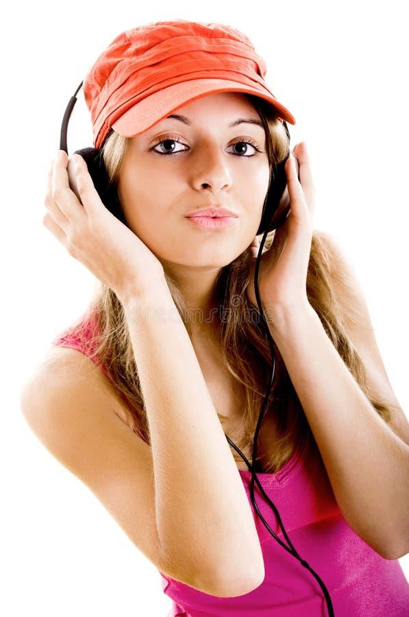 A mulher nova escuta música fotos de stock royalty free