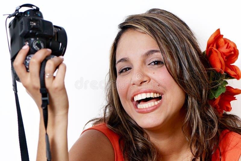 Mulher nova feliz com câmera foto de stock royalty free
