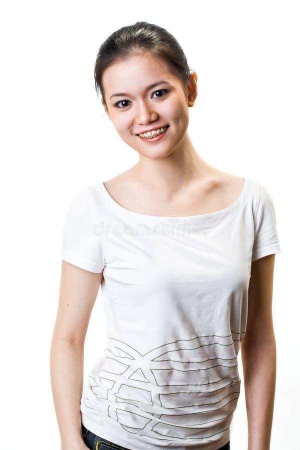 Mulher nova feliz com cintas foto de stock