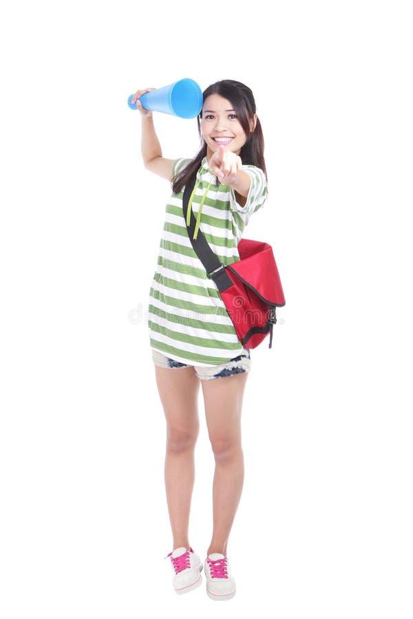 Mulher nova feliz do estudante que aponta em você foto de stock