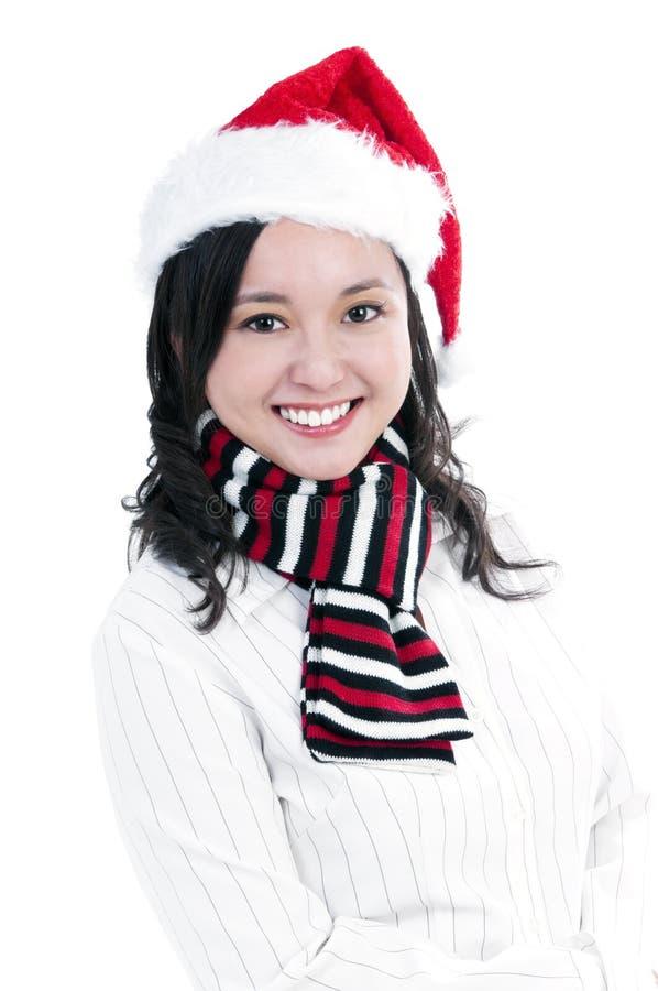 Mulher nova feliz que desgasta o chapéu de Santa imagens de stock royalty free
