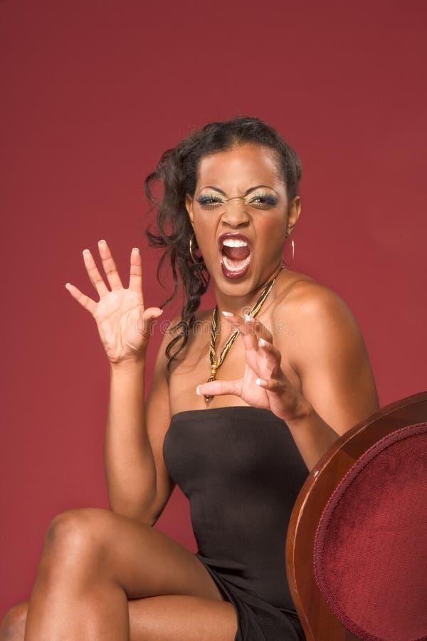 Mulher nova glamoroso étnica gritando emocional fotos de stock