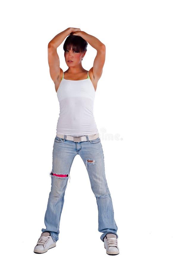 Mulher nova isolada com suas mãos em sua cabeça imagem de stock royalty free