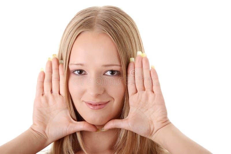 Download A Mulher Nova Molda Sua Face Com Mãos Foto de Stock - Imagem de senhora, bonito: 10053240