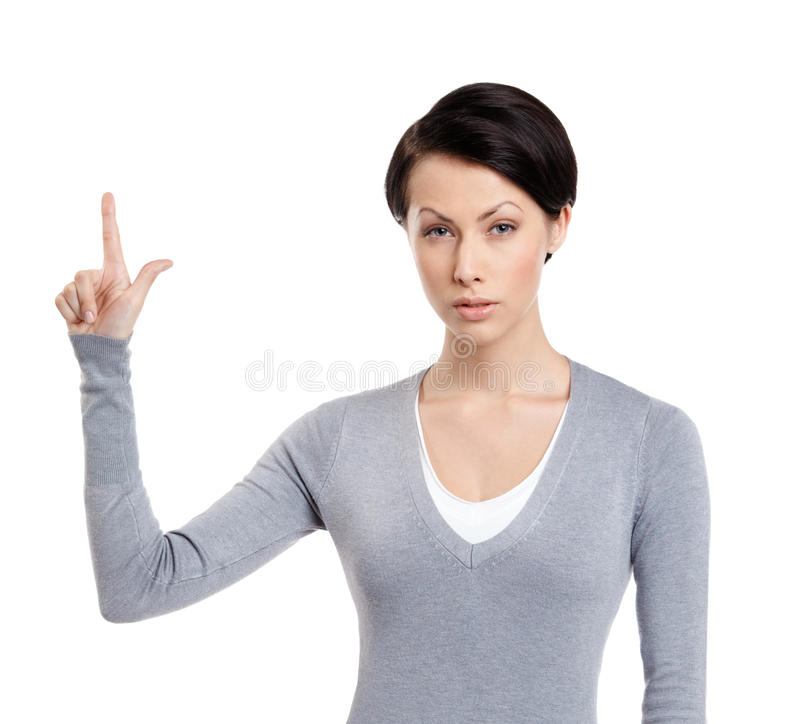 A mulher nova mostra o forefinger, sinal da atenção foto de stock