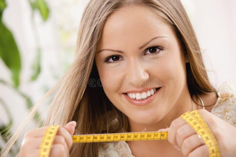 Mulher nova na dieta foto de stock