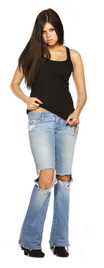 Mulher nova nas calças de brim foto de stock