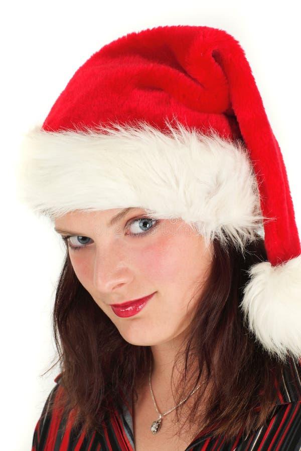 Mulher nova no chapéu de Santa imagem de stock royalty free