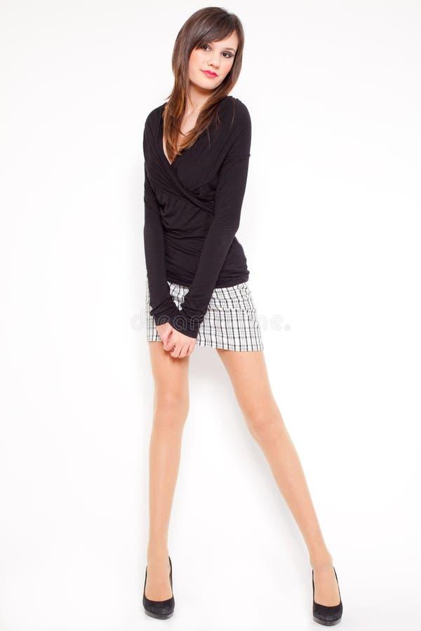 Mulher nova no fundo branco fotografia de stock