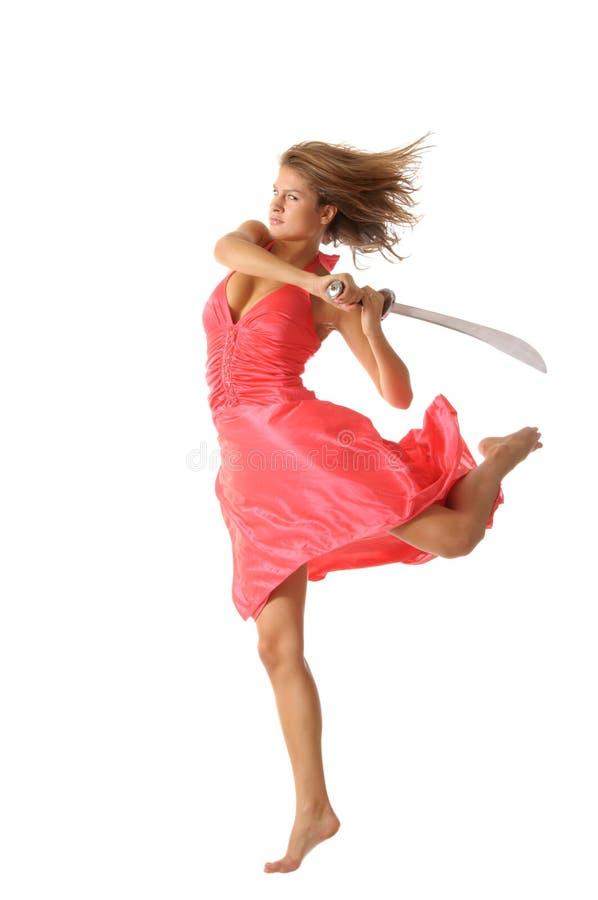 Mulher nova no salto com espada fotografia de stock