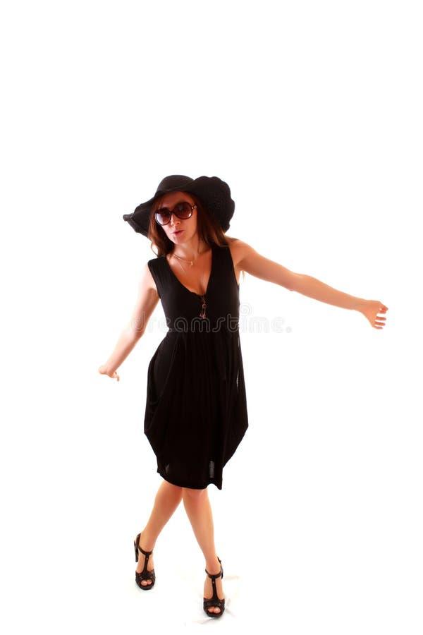 Mulher nova no vestido preto imagem de stock royalty free