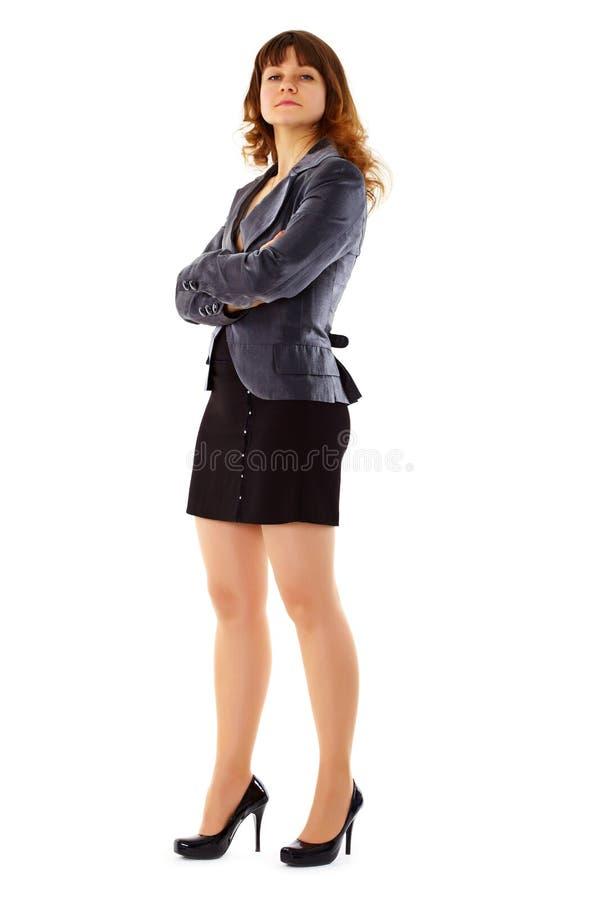 Mulher nova orgulhosa em um terno de negócio imagens de stock royalty free