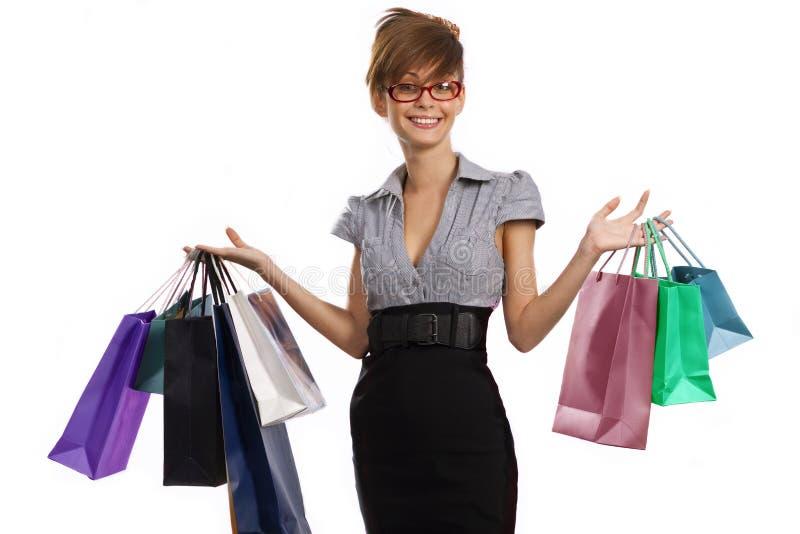 Download Mulher Nova Que Admira Sua Compra Imagem de Stock - Imagem de consumo, vidros: 16871481