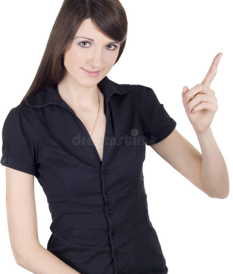 Mulher nova que aponta seu dedo no copyspace foto de stock royalty free