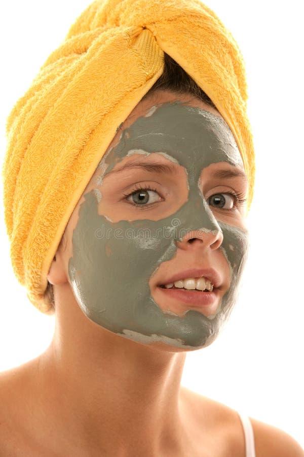 Mulher nova que desgasta o creme facial foto de stock royalty free