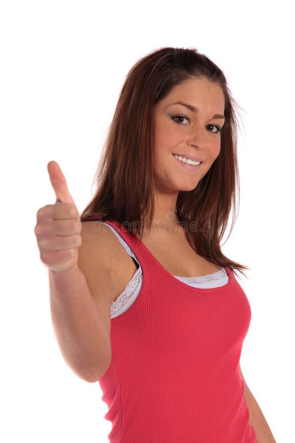 Mulher nova que faz o gesto positivo foto de stock