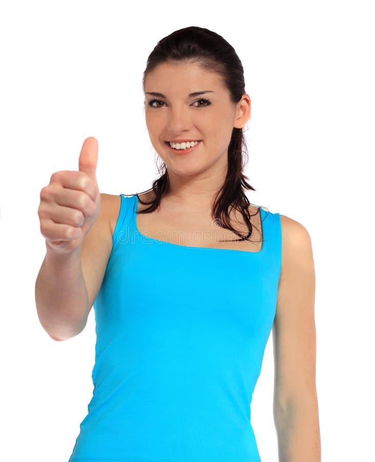 Mulher nova que faz o gesto positivo imagem de stock royalty free