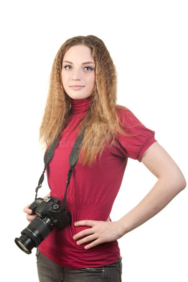 Mulher nova que levanta com a câmera profissional da foto fotografia de stock