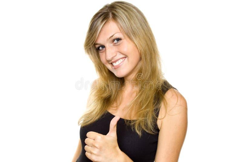 Mulher nova que mostra os polegares acima fotografia de stock royalty free