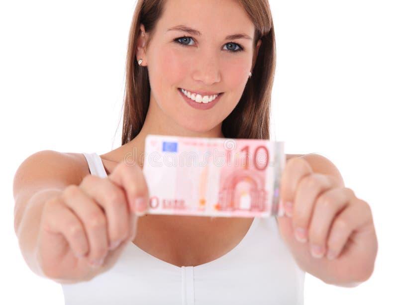 Mulher nova que prende o euro 10 fotografia de stock royalty free