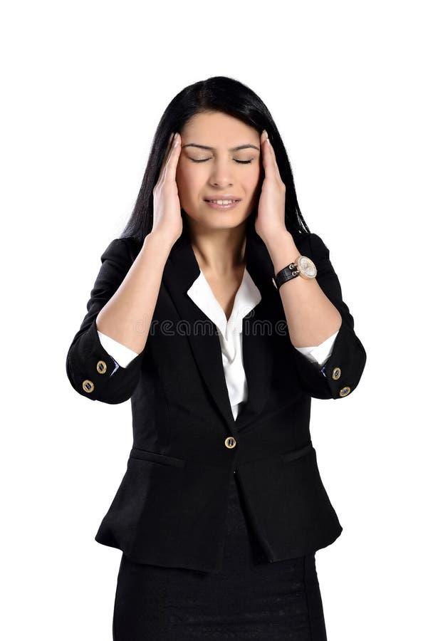 Mulher nova que tem uma dor de cabeça fotos de stock