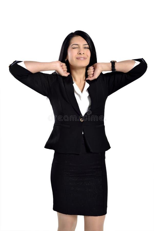 Mulher nova que tem uma dor de cabeça fotografia de stock royalty free