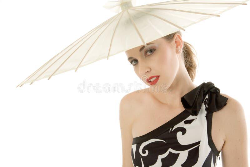 Mulher nova 'sexy' com guarda-chuva imagens de stock royalty free