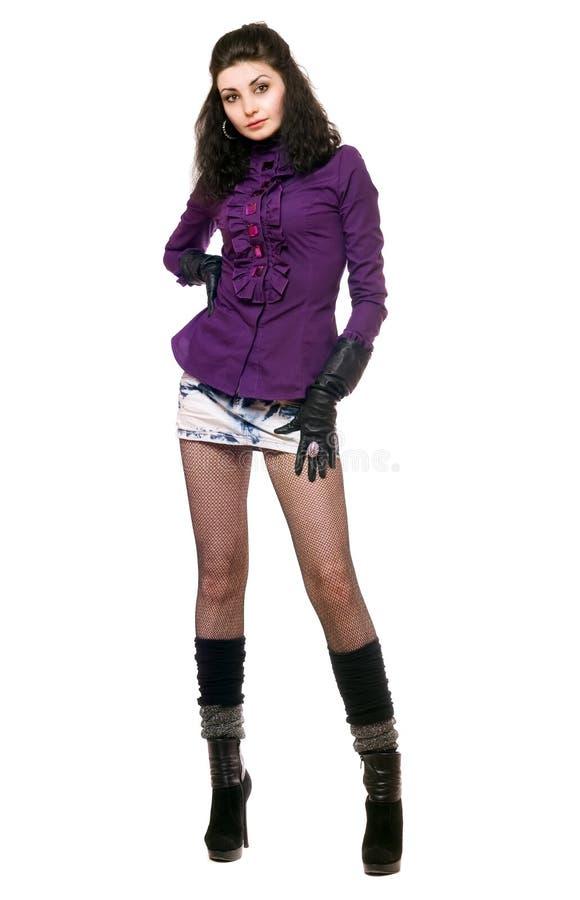 Mulher nova 'sexy' em uma saia da sarja de Nimes imagem de stock royalty free