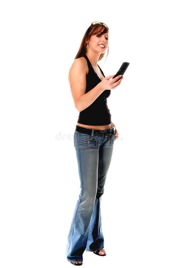 Mulher ocasional com telefone de pilha fotos de stock royalty free