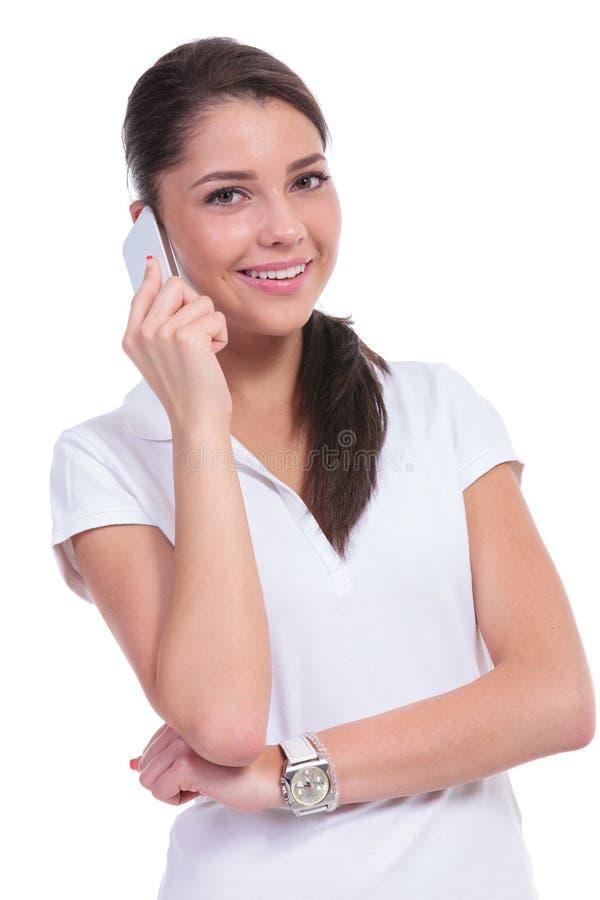 Mulher ocasional no telefone fotografia de stock royalty free