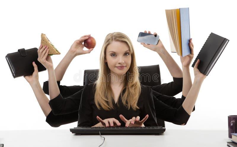 Mulher ocupada em sua mesa foto de stock royalty free