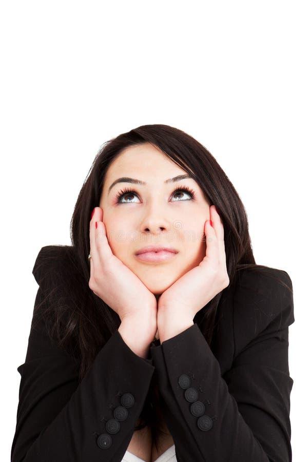 Mulher pensativa do negócio que tem uma idéia fotos de stock