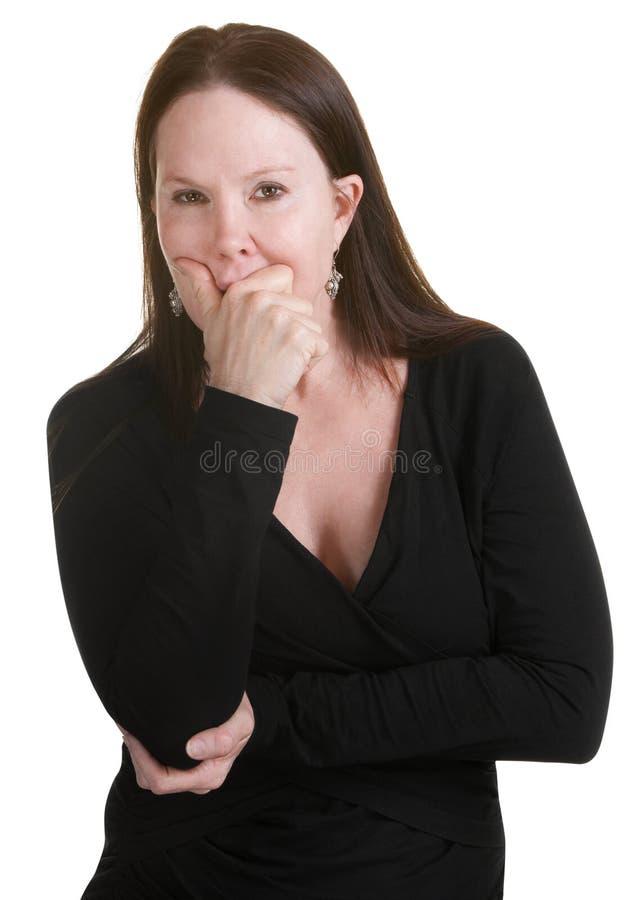 Mulher pensativa no preto foto de stock royalty free