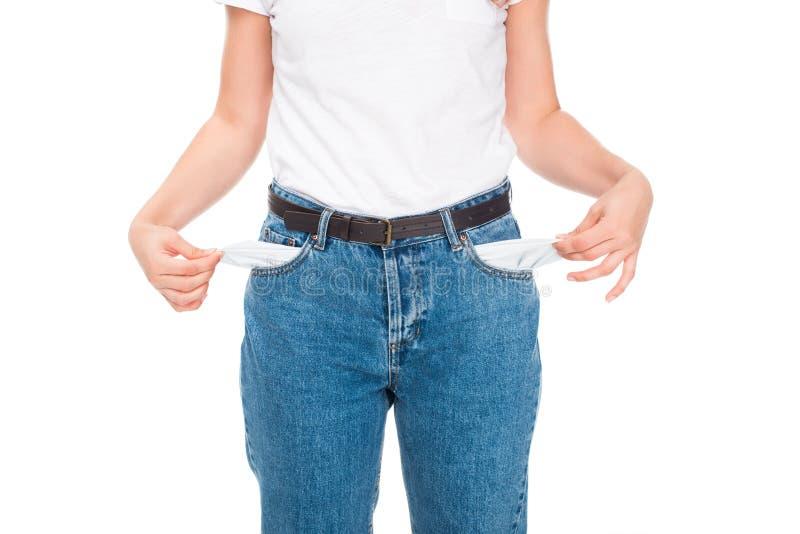 Mulher pobre com bolsos vazios foto de stock