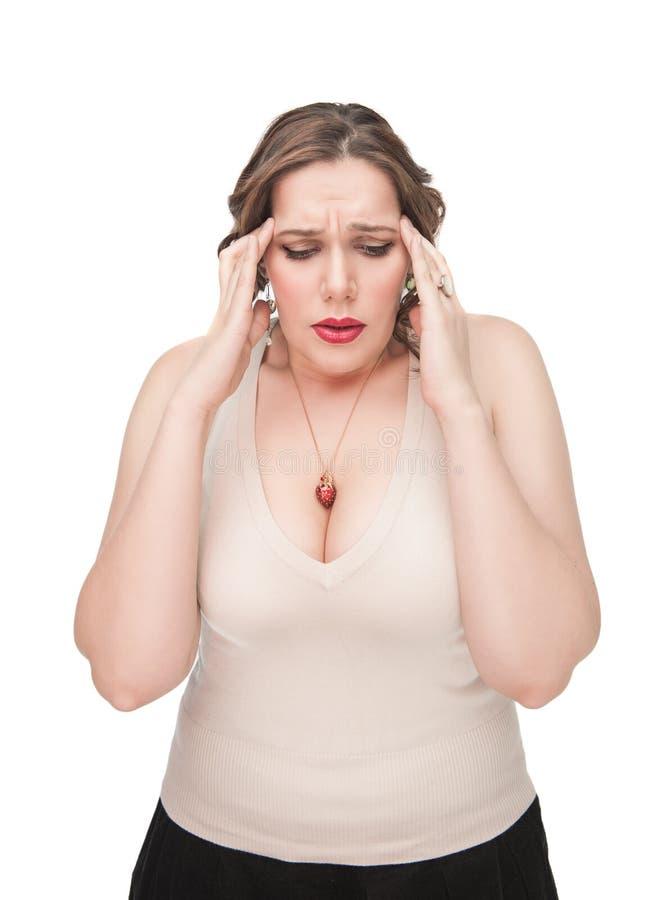 Mulher positiva do tamanho com dor de cabeça fotografia de stock